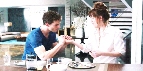 Jamie and Dakota in a scene from FSOG in the kitchen<3