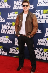 Chris Evans wearing a brown jacket<3