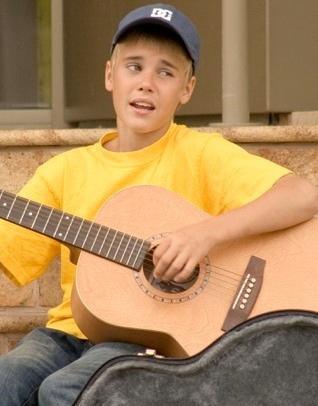 Justin busking.