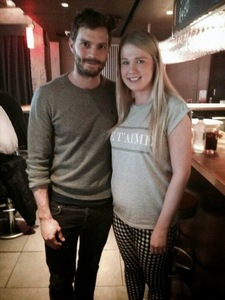 Jamie with a fan in a bar<3