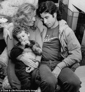 John looking down at his deceased gf's son in '77 <3333