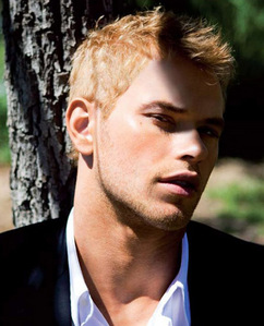 Kellan with part of his face in shade<3