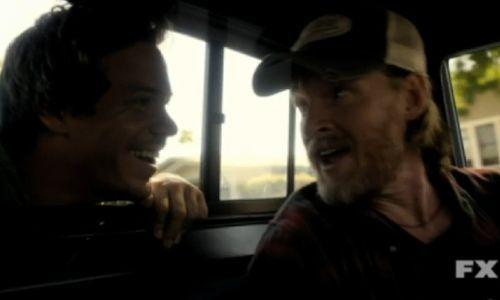 Mikey(Britt) smiling at Donal Logue(Hank)
