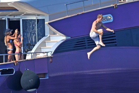 Kellan jumping off the back of a yacht<3<3