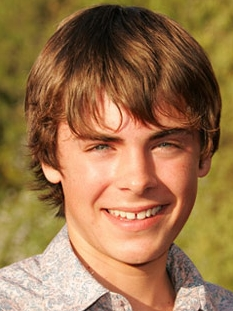a young Zac Efron with a slight gap in his teeth(but he no longer has it)<3