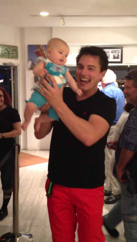 John dancing with a baby.