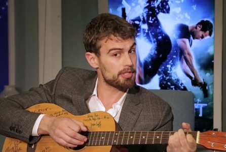 Theo with a guitar<3