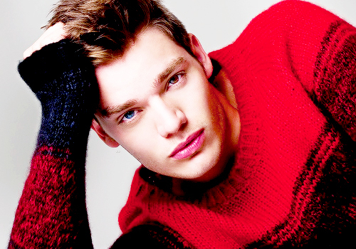 Dominic in a red sweater<3