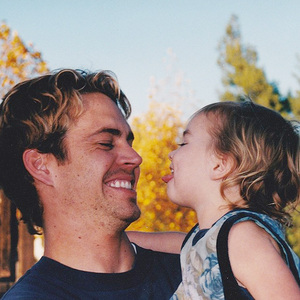 Paul smiling at his daughter Meadow,when she was a baby(she's now 15 atau 16)<3