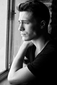Colton looking out of a window<3