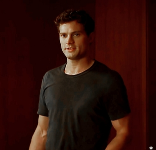 Jamie in a scene from FSOG where he's all sweaty after a run<3