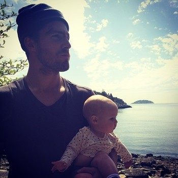 Stephen and his daughter looking to the side<3