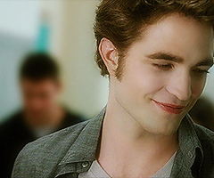 Robert with a sexy,gorgeous half smile<3