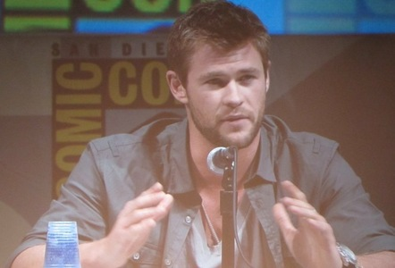 Chris at Comic Con with a mike in front of him<3
