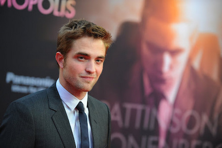 my super handsome British babe standing suivant to himself on the Cosmopolis poster<3
