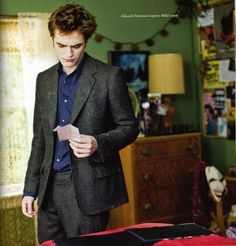 my hot vampire babe looking at a pic of Bella and him in a scene from New Moon<3