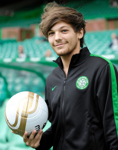 Lou holding a football!