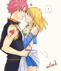 Natsu loves Lucy I am sure of it,but since he is dense he doesnt realize it at all,as for Lucy,sure she is smart but she can be a little clueless about her own love life.In short....theyre both dense about love.