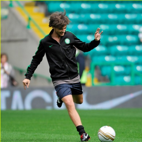 Here is the cutie playing football <3<3<3