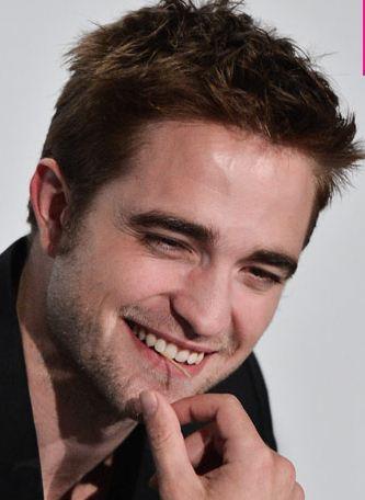 Robert touching his sexy chin<3