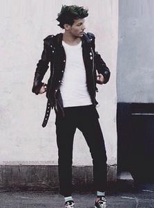 This is a pic of Louis wearing a biker jacket. Sooooooooo hot if you ask me!!! :D