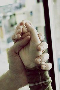 Robert sexy hand holding Kristen's lovely hand<3