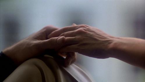 John's hand holding Karen's :)