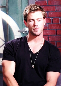 Chris in a black v neck shirt<3