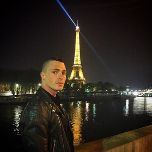 Colton with a nice background of the Eiffel Tower at night :)