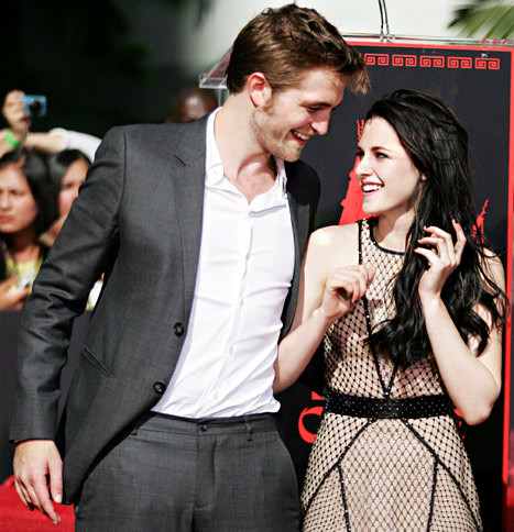 Rob smiling at the beautiful,lovely Kristen<3
