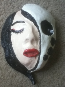 I tried drawing this art of Azula one time but it didn't work out so well so I made a clay thing based on it instead.