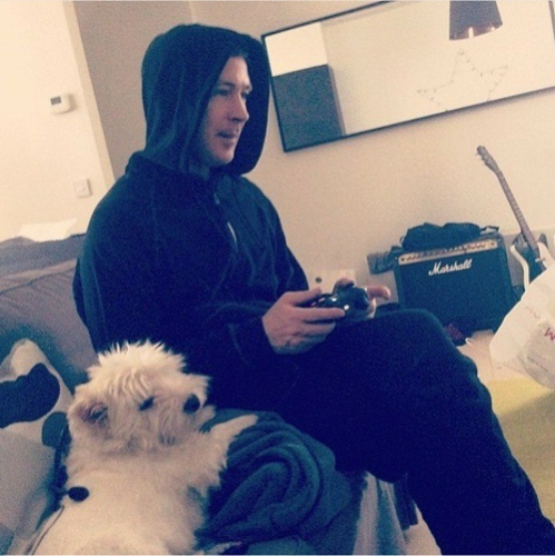 Aidan with a puppy, playing a video game and a 吉他 in the background - he could totally be my best buddy