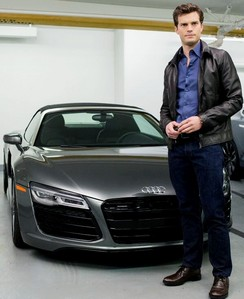 Christian Grey(Jamie Dornan) seguinte to one of his many fancy cars...boys and their toys<3