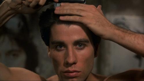 John grooming his hair :)