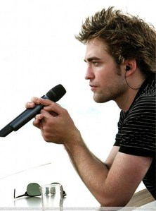 Robert holding a mike<3