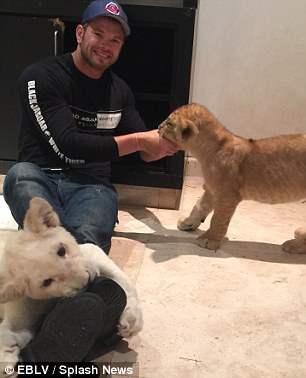 Kellan with 2 adorable lion cubs<3