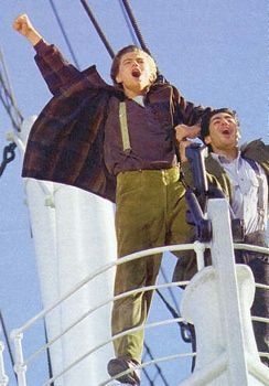 Leo standing up on the bow of Titanic<3