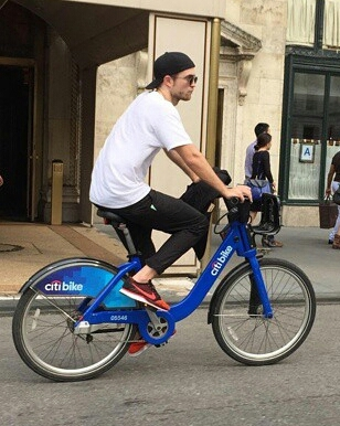 my babe riding a bike outside in the streets of NY<3
