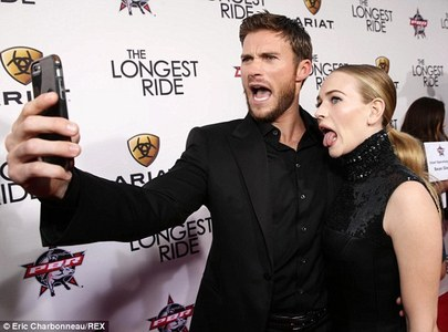 Scott taking a pic of himself and his Longest Ride co-star,Brit Robertson<3