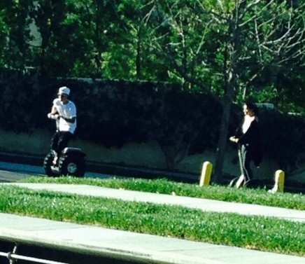 Justin and Selena riding segway scooters:)
