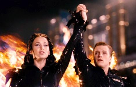 Josh Hutcherson and Jennifer Lawrence with fire:)