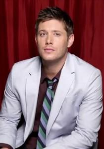 Jensen wearing a white giacca