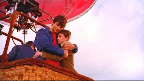 Clark Kent 'Tom Welling' and Ryan James 'Ryan Kelley' hugging in Smallville.
