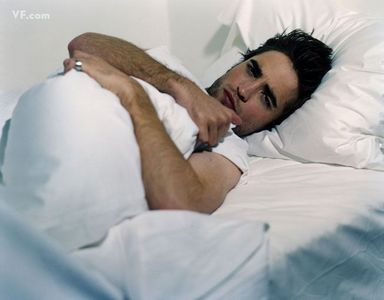 my babe looking rather cozy where he belongs...in my bed<3