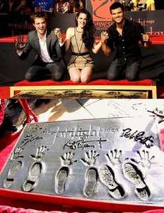 the Twilight Musketeers(Robert,Kristen and Taylor)getting their hands and feet immortalized in cement in November 2011<3