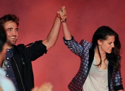 my beloved Robsten holding hands<3