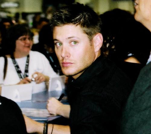 Jensen wearing a black sando