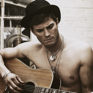 Jamie with a guitar<3