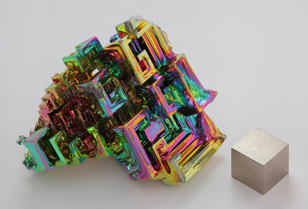 "Perhaps not technically a ""gem"", but bismuth crystal is very cool. It's an element unto itself (you'll find it on the periodic table) and naturally forms awesome spiral structures. The surface then oxidises to create the iridescent glow of pelangi colours anda see below. A very cool metal."