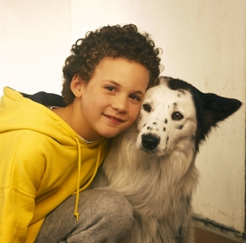 Young Ben Savage (one of Rider's co stars) with a dog :)